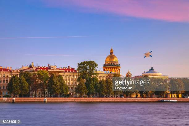 st. petersburg at dusk along the neva river - winter palace st. petersburg stock photos and pictures