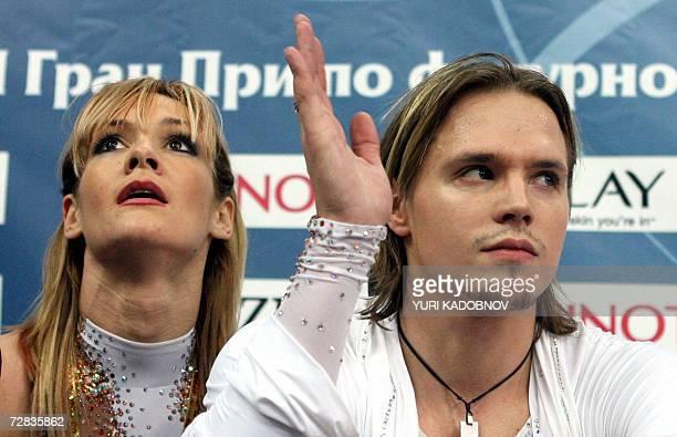 Bulgarian ice dancers Albena Denkova and Maxim Staviski wait for the results after their original dance at the figure skating ISU Grand Prix final in...