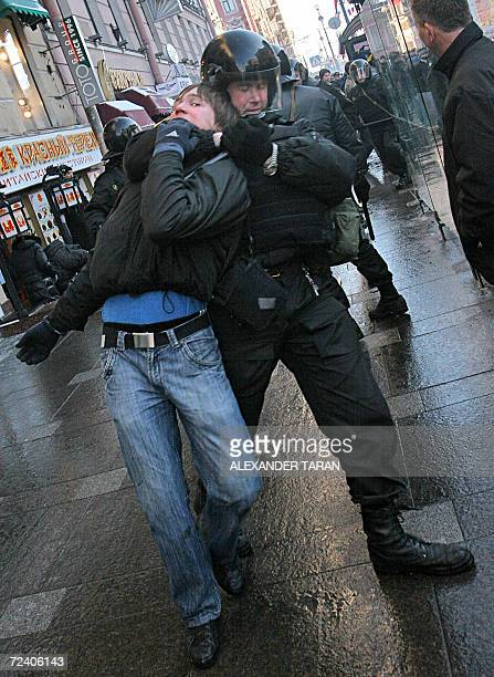 Russian policeman arrests a nationalist protestor during a rally marking National Unity Day in St Petersburg 04 November 2006 Nationalists began a...