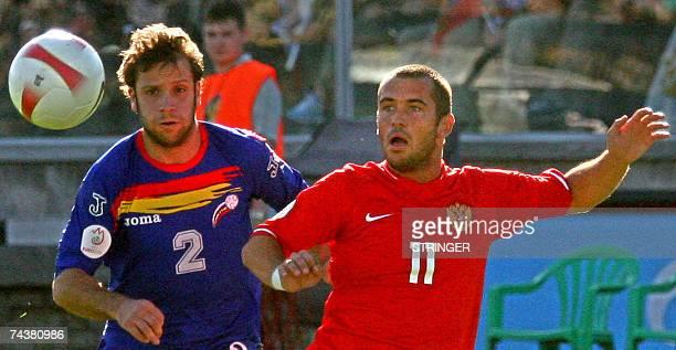 Russia's Alexander Kerzhakov vies with Andorra's Jose Manuel Ayala during their Euro 2008 football qualifying match in StPetersburg 02 June 2007 AFP...