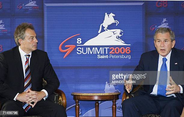 St Petersburg, RUSSIAN FEDERATION: US President George W. Bush speaks to British Prime Minister Tony Blair at the Konstantinovsky Palace Complex in...