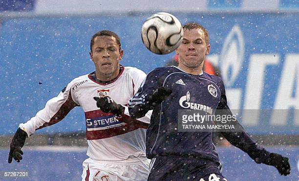 St Petersburg, RUSSIAN FEDERATION: Zenit's Russia Aleksander Anukov vies with Sevilla's French Adriano Correia during their quater final of the UEFA...