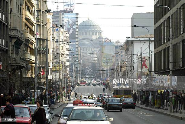 St Sava Cathedral is shown in the background as cars travel along a street March 14 2003 in the Serbian capitol of Belgrade Religious Patriarch Pavel...