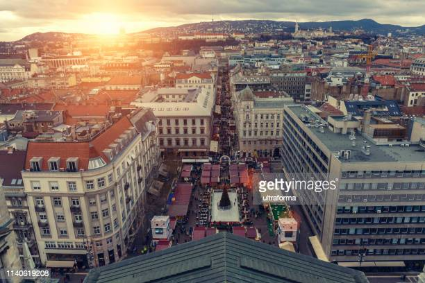 st stephen's basilica square and zrinyi street with christmas market in budapest at sunset - hungarian culture stock photos and pictures