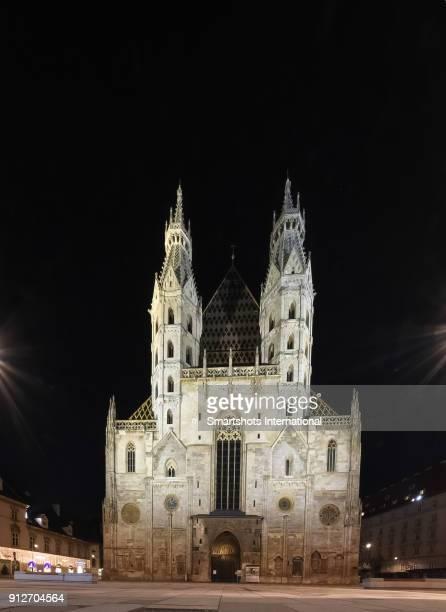 St. Stephen's Cathedral facade illuminated at night in Vienna, Austria