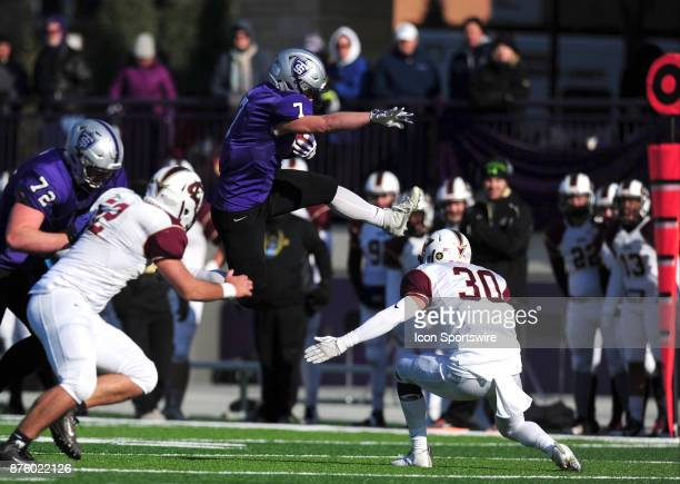 St Thomas wide receiver Joe Reed hurdles Eureka Red Raiders defensive back Ross Royal while scoring a touchdown during the preliminary round of the...