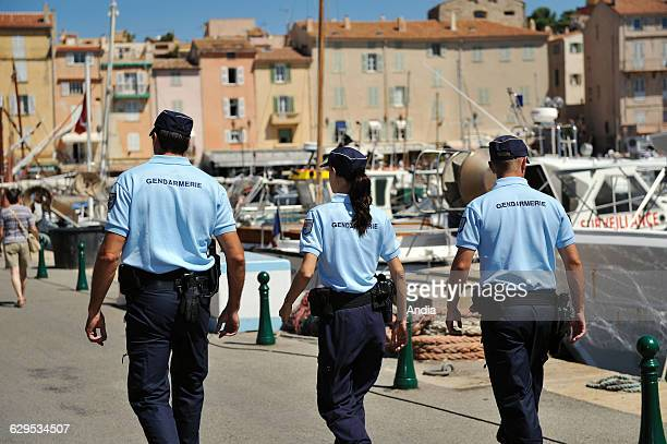 St Tropez Gendarmes of the local company of Gassin Saint Tropez viewed from behind on patrol along the quays