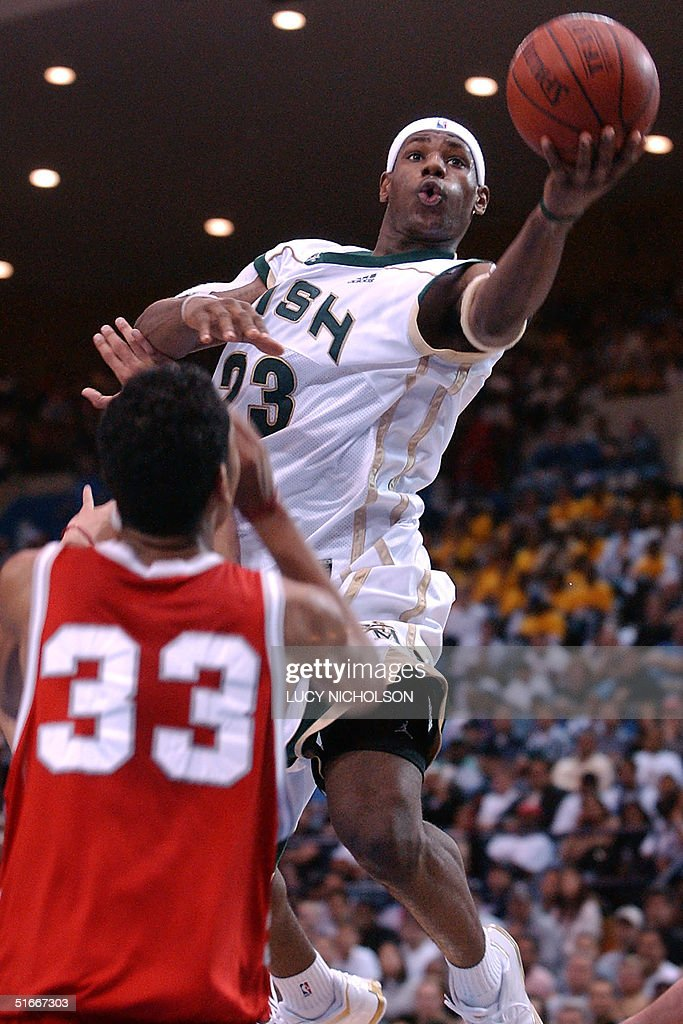 St. Vincent-St. Mary's LeBron James (R) goes up for a basket past Mater Dei's Marcel Jones in the second quarter, in Los Angeles, CA, 04 January 2003. St. Vincent-St. Mary won 64-58 with James scoring 21 points. James, 17, is expected to be the number one pick in the NBA draft this spring, following Kevin Garnett and Kobe Bryant in entering the NBA from high school. AFP PHOTO/Lucy Nicholson