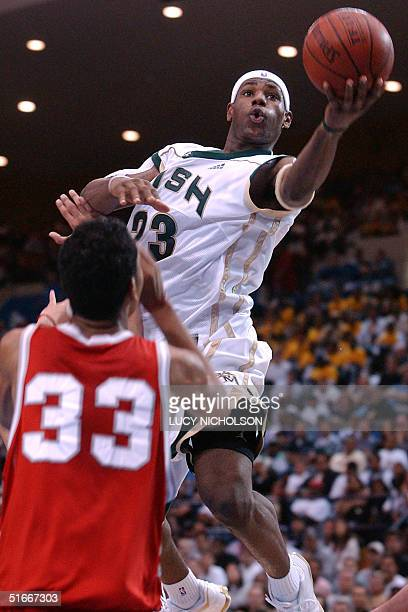 St VincentSt Mary's LeBron James goes up for a basket past Mater Dei's Marcel Jones in the second quarter in Los Angeles CA 04 January 2003 St...