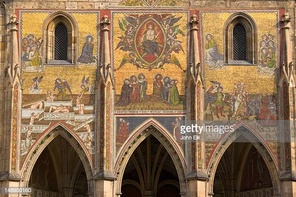 st vitus cathedral facade with mosaics in prague castle. - hradcany castle stock pictures, royalty-free photos & images