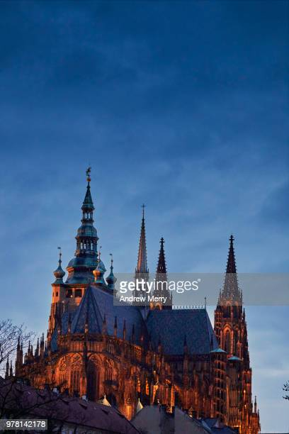 st. vitus cathedral, prague castle, hradcany, at night and illuminated by orange floodlight against dark blue sky - st vitus's cathedral stock pictures, royalty-free photos & images