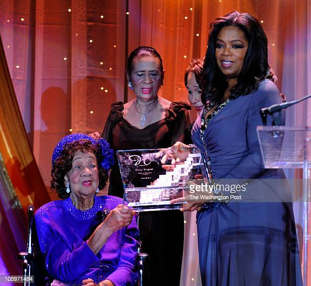 st_oprah5 6/4/09 208188 Washington DC Post Photos by Richard A Lipski Oprah Winfrey holds up award with Dorothy Height and Dr Thelma Daley onstage at...