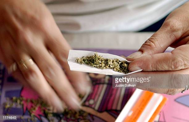 Staarla Heaney hand rolls marijuana cigarettes at the San Francisco Patients Cooperative a medical cannabis cooperative July 25 2002 in San Francisco...