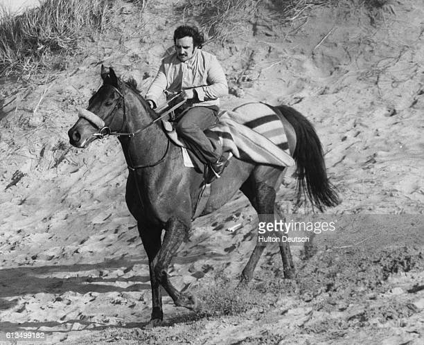 Stable hand Billy Ellison takes Grand National winner Red Rum for a training session on the beach at Southport in preparation for a forthcoming trial...