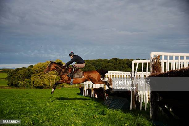 Stable Jockey Michael Nolan riding Catherines Well on the lower schooling ground at Sandhill Racing Stables on September 22 2015 in Minehead England...