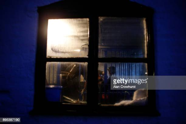 A stable lad prepares his horse for morning exercise at Nicky Hendersons Seven Barrows stables on December 19 2017 in Lambourn United Kingdom