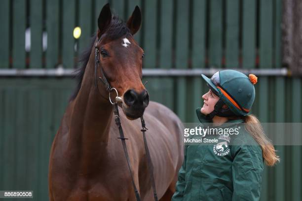 Stable lass Fay Shulton alongside Blaklion during a stable visit to the yard of national hunt trainer Nigel TwistonDavies at Grange Hill Farm on...