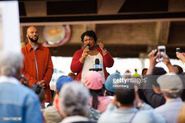 Stacey Abrams Democratic nominee for governor of Georgia center speaks as musical artist Common listens during a rally ahead of a Souls to the Polls...