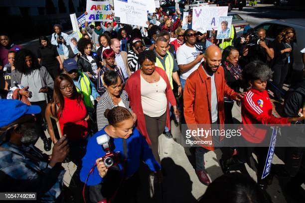Stacey Abrams Democratic nominee for governor of Georgia center left and musical artist Common center right lead a Souls to the Polls march in...