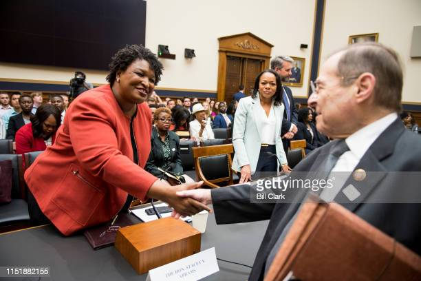 Stacey Abrams, former Democratic leader in the Georgia House of Representatives and founder and chair of Fair Fight Action, shakes hands with...