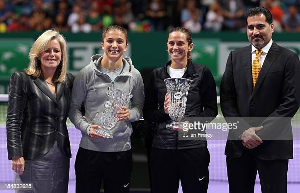 WTA CEO Stacey Allaster Sara Errani Roberta Vinci of Italy with their year end No1 trophies and Salah Talak Senior Vice President of Corporate...
