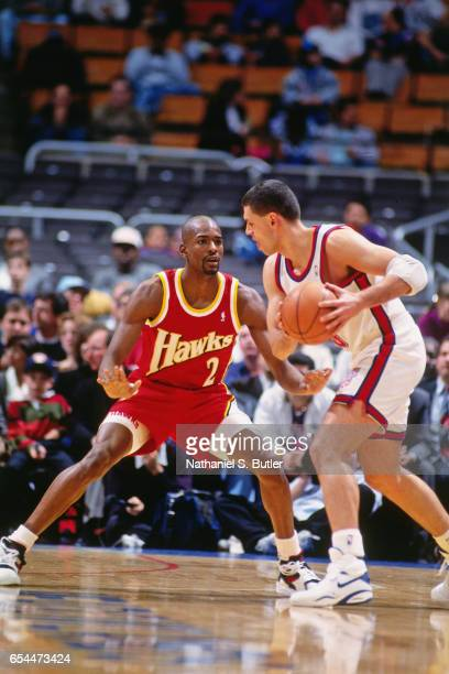 Stacey Augmon of the Atlanta Hawks defends against the New Jersey Nets during a game played circa 1993 at the Continental Airlines Arena in East...