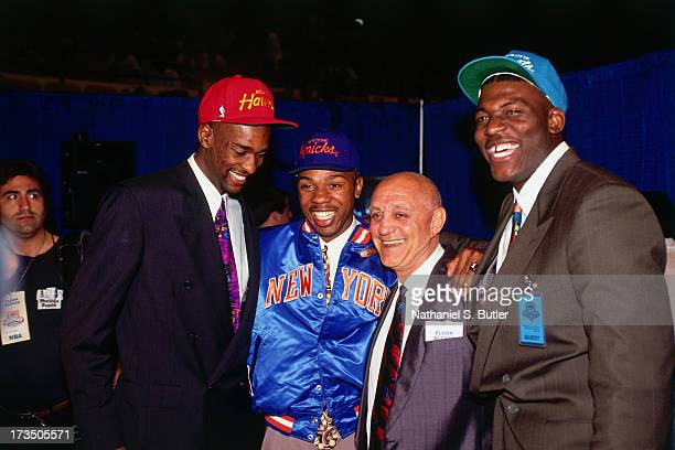 Stacey Augmon of the Atlanta Hawks Greg Anthony of the New York Knicks and Larry Johnson of the Charlotte Hornets pose with their college head coach...