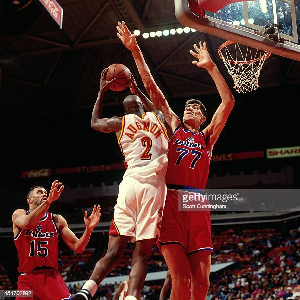 Stacey Augmon of the Atlanta Hawks shoots against the Washington Bullets circa 1994 at the OMNI in Atlanta Georgia NOTE TO USER User expressly...