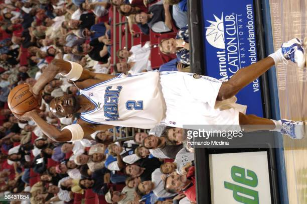 Stacey Augmon of the Orlando Magic attempts a shot against the Portland Trail Blazers November 25 2005 at TD Waterhouse Centre in Orlando Florida...