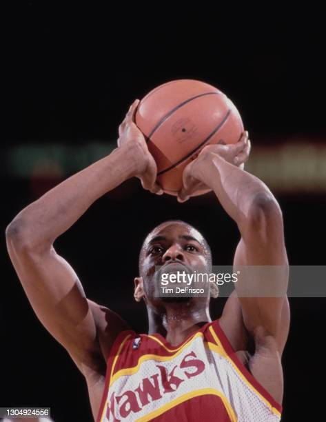 Stacey Augmon, Shooting Guard and Small Forward for the Atlanta Hawks attempts a free throw during the NBA Midwest Division basketball game against...