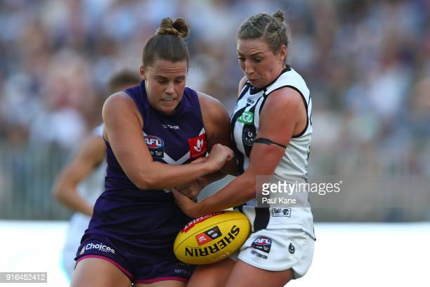 Stacey Barr of the Dockers and Amelia Barden of the Magpies contest for the ball during the round two AFLW match between the Fremantle Dockers and...