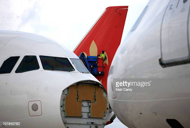 Stacey Bewick, an employee of Air Salvage International, removes panels on the tail of a 737 600 currently being dismantled on June 9, 2010 in...