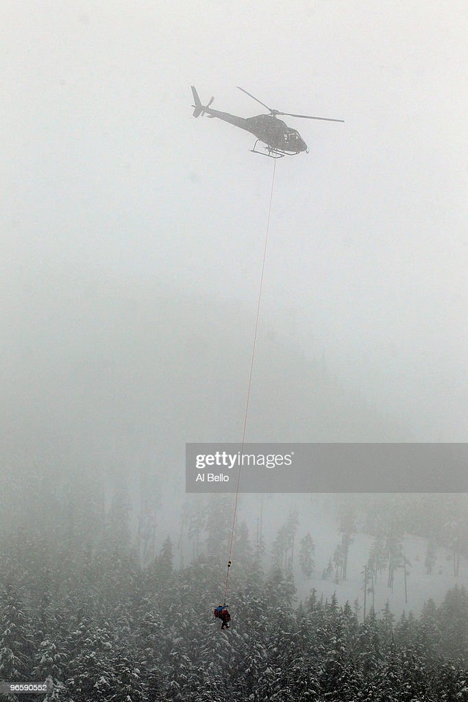 Stacey Cook of United States is air-lifted off the slope by helicopter during the Ladies Downhill training run at Whistler Creekside ahead of the Vancouver 2010 Winter Olympics on February 11, 2010 in Whistler, Canada.
