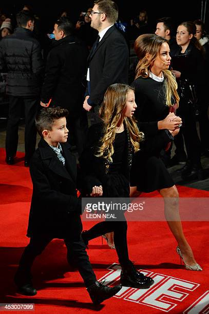 Stacey Cooke wife of Manchester United's Ryan Giggs walks with their children Zachary and Liberty as they arrive the world premiere of the...