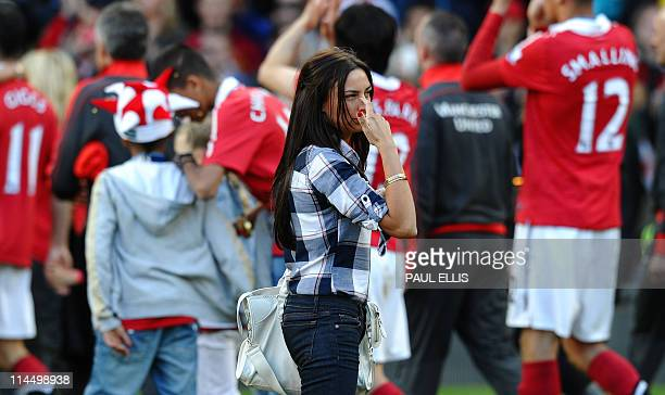 Stacey Cooke wife of Ryan Giggs looks on after the English Premier League trophy presentation after their match against Blackpool at Old Trafford in...