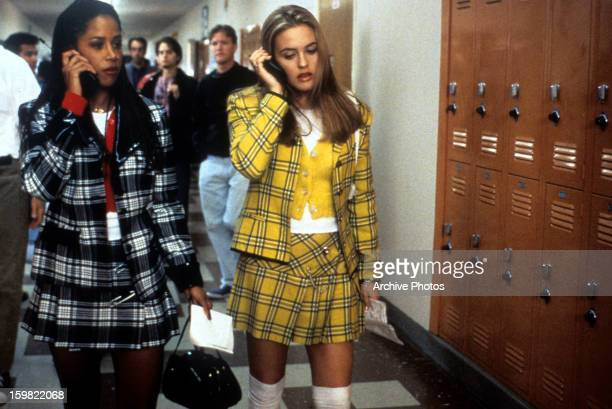Stacey Dash and Alicia Silverstone walking and talking on their mobile phones in a scene from the film 'Clueless', 1995.