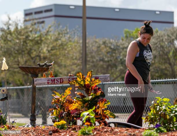 Stacey Faber visits a makeshift memorial outside of Marjory Stoneman Douglas High School in Parkland, Fla., on Friday, Feb. 14 during the two-year...