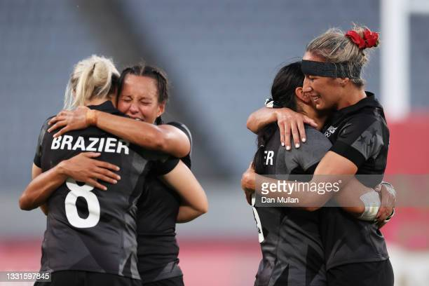 Stacey Fluhler and Sarah Hirini of Team New Zealand celebrate after defeating Team France in the Women's Gold Medal match between Team New Zealand...