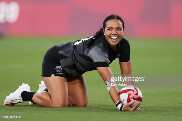 Stacey Fluhler of Team New Zealand celebrates scoring a try in the Women's Gold Medal match between Team New Zealand and Team France during the Rugby...