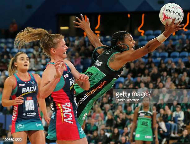 Stacey Francis of the West Coast Fever attempts to intercept the pass during the round 13 Super Netball match between the Fever and the Vixens at...
