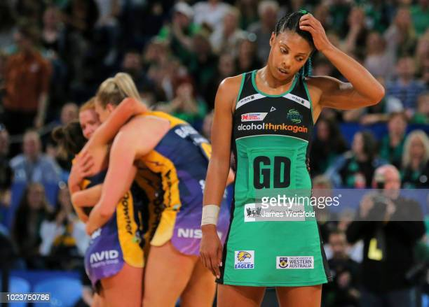 Stacey Francis of the West Coast Fever looks away as the Sunshine Coast Lightning Celebrate during the Super Netball Grand Final match between the...