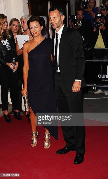 Stacey Giggs and Ryan Giggs arrives at the GQ Men of the Year Awards 2010 at the Royal Opera House on September 7 2010 in London England