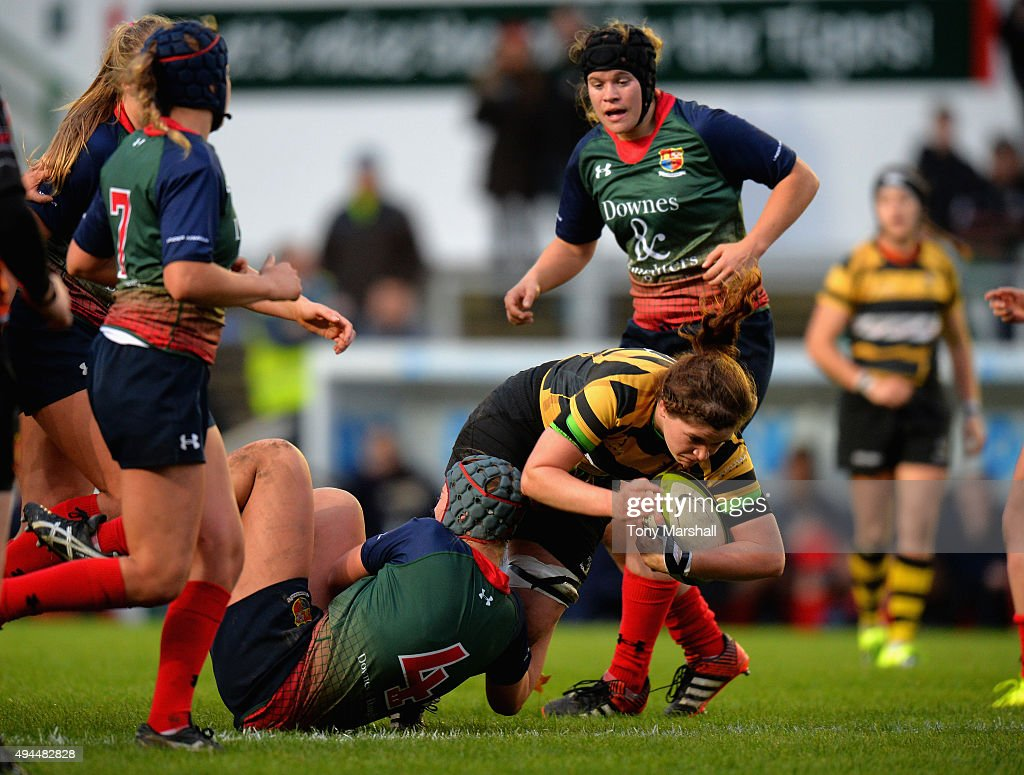 Stacey Hiscox of Lichfield Ladies tackles Laura Quinn of Wasps Ladies during the Womens Premiership match between Lichfield Ladies and Wasps Ladies at Welford Road on October 25, 2015 in Leicester, England.