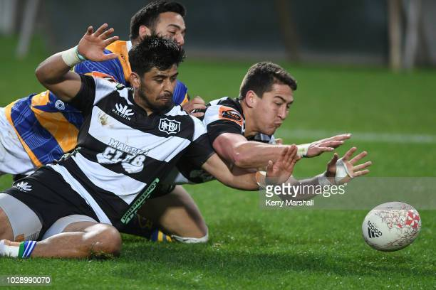 Stacey Ili and Tiaan Falcon of Hawke's Bay dive to ground the ball and stop a try during the round four Mitre 10 Cup match between Hawke's Bay and...