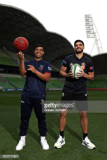 Stacey Ili of the Melbourne Rebels and his brother Shea Ili of Melbourne United pose during a Melbourne United of the NBL and the Melbourne Rebels of...