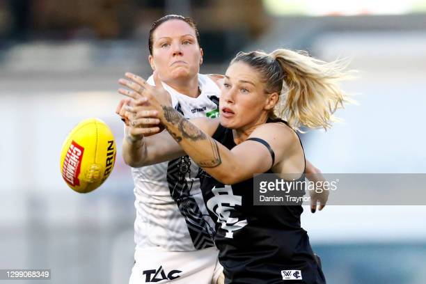 Stacey Livingstone of Collingwood spoils Tayla Harris of Carlton during the round one AFLW match between the Carlton Blues and the Collingwood...