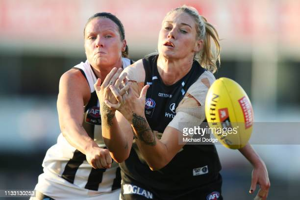 Stacey Livingstone of the Magpies competes for the ball against Tayla Harris of the Blues during the round five AFLW match between the Carlton Blues...