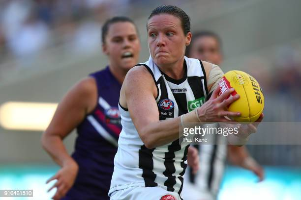 Stacey Livingstone of the Magpies looks to pass the ball during the round two AFLW match between the Fremantle Dockers and the Collingwood Magpies at...