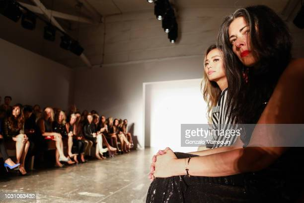 Stacey London and Jamie Chung front row during the Nicole Miller Spring 2019 Runway Show Approvals on September 6 2018 in New York City