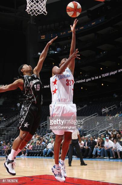 Stacey Lovelace of the Atlanta Dream shoots a layup under pressure against Vickie Johnson of the San Antonio Silver Stars during the WNBA game on...